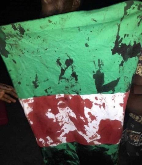 blood stained flag of Nigeria, #endsars protest